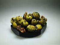 Olijven met walnoot en basilicum